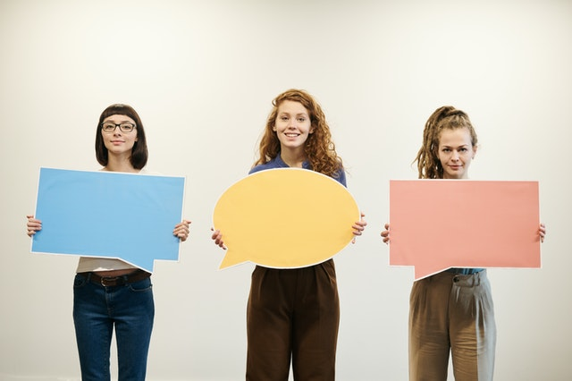 https://www.pexels.com/photo/three-women-holding-bubble-text-cards-3184401/